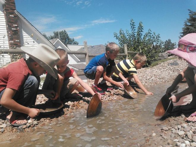 "Kids pan for ""gold"" at the Overland Trail Museum."